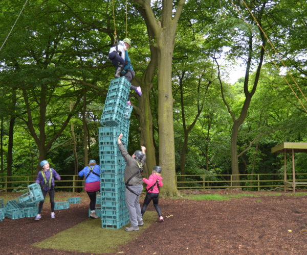 family group crate stacking at Outdoor Elements