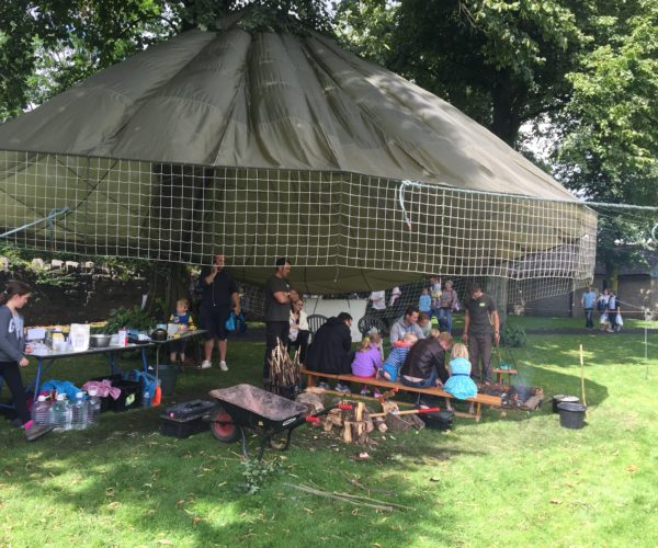 Clitheroe food festival - baking bread on a camp fire